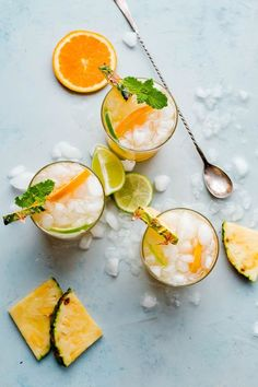 A refreshing pineapple punch recipe made with pineapple juice, orange juice, rum, lime juice, and ginger beer for a bit of a spicy punch. A delicious cocktail for summer! Easy Cocktails, Summer Cocktails, Cocktail Drinks, Cocktail Recipes, Cocktail Club, Milk Shakes, Beer Punch, Cheers, Aperol
