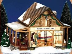 - #55054 Introduced in 2000 Retired in 2002. - Double doors for large sporting equipment - Covered board porch with seating area on side. - Dept 56 Snow Village Timberlake Outfitters Workshop #55054 5