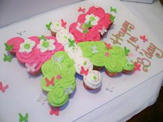 Beautiful Butterfly cupcake cake   The lil fake butterflys all over it are a bit much...but the cupcake part looks great!