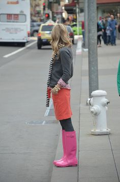 pink Hunter boots + coral skirt