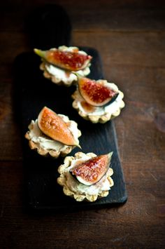 theraconteurasaurus: Fig, mascarpone, and pistachio tartlets.