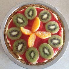 Cheesecake with fresh strawberry purée, slices of fresh kiwi and orange!