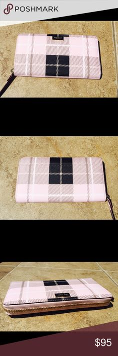 "Kate Spade Neda Wallet Classic pink and black plaid design on this Kate Spade Neda Newbury Lane zip wallet. Slip pocket along backside. Zipper opens to 12 card slots, 2 bill slots, zip pocket, and 3 open gusset pockets. 7.75"" x 4"" x 1"". NWT. NO TRADES kate spade Bags Wallets"