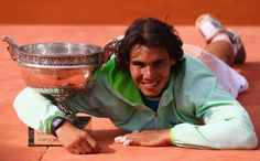 Rafael Nadal  Rafael Nadal of Spain celebrates with the trophy after winning the men's singles final match between Rafael Nadal of Spain and Robin Soderling of Sweden on day fifteen of the French Open at Roland Garros on June 6, 2010 in Paris, France.