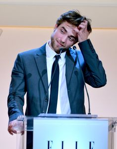 Pin for Later: Robert Pattinson's Hottest Hand-in-Hair Moments  Robert couldn't help reaching for his man while delivering a speech at Elle's Women in Hollywood event in LA in October 2012.