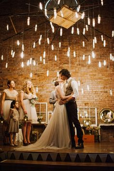 The unique chandelier surrounding the couple gives this ceremony such a magical feel | Jac & Heath Photography