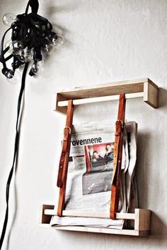 Magazine rack made with ikea spice rack and leather belts