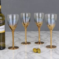 A delightful set of four elegant wine glasses finished in deep brass gold ombre colouring.  These glasses are a suitable addition to any dinner party table, an eye catching collection. Featuring a transparent glass top and a gold finish to the bottom stem of the glass.  Whether this set is for a party night or simply relaxing in the lounge the simple yet sophisticated design can thoroughly be admired, the perfect addition to your glassware!