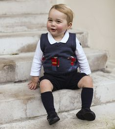 Prince George in a Cath Kidston pullover, Polarn O. Pyret bodysuit, Start Rite shoes and Amaia Kids shorts.