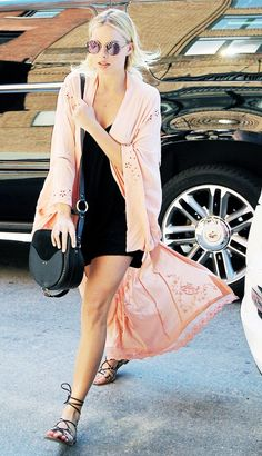Margot Robbie adds a kimono for instant fashion girl vibes.