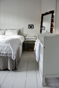 Simple white #bedroom #fairylights around a mirror