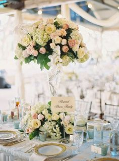 Photographer: Ryan Ray Photography; Charming blush and yellow floral wedding reception centerpiece;