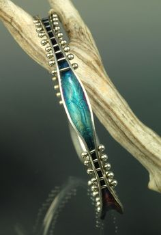 Gorgeous anticlastic bracelet. I so want the tools to make things like this!  Andrea Guarino Slemmons