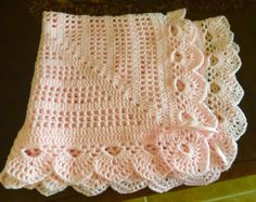 Handmade crocheted baby blanket. I only use quality yarn which feels very soft to the touch. Machine washable and dryer safe. Wonderful heirloom which can be passed from generation to generation for either a boy or girl. Comes from a smoke free home.  Feel free to visit my shop for other crochet baby items http://www.etsy.com/shop/jesjaymat  Item usually ships within 48 hours and goes out Priority Mail. Delivery Confirmation is ALWAYS used!  ALL BLANKETS CAN BE MADE IN ANY...