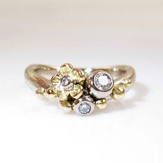 Galleri Castens - Vielsesringe med blomster og diamanter