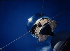 Vanguard Satellite, 1958: One of the Vanguard satellites is checked out at Cape Canaveral, Florida in 1958. Vanguard 1, the world's first solar-powered satellite, launched on St. Patrick's Day (March 17) 1958. It was designed to test the launch capabilities of a three-stage launch vehicle and the effects of the environment on a satellite and its systems in Earth orbit.