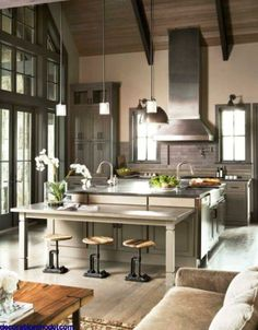 Open kitchen with high ceiling.
