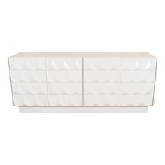 White lacquered wood sideboard with triangular relief patterning.