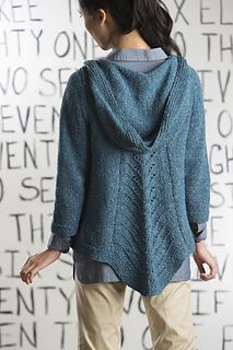 A dramatic feather-and-fan panel makes a pointed back hem in this unusual hooded cardigan. The hood, fronts, and back are worked from the top down, while sleeves are worked from the bottom up.