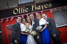 bridal party outside ollie hayes bar, moneygall, co. tipperary