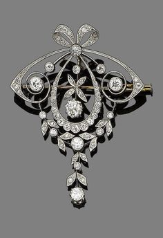 A belle époque diamond brooch/pendant, circa 1905  In the garland style, the cushion-shaped diamond bow surmount suspending a similarly and old brilliant-cut diamond drop, terminating in a similarly-set diamond swag of floral design, mounted in silver and gold, diamonds approx. 1.60cts total, length 5.8cm