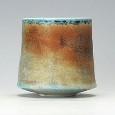Jack Doherty porcelain tea bowl. slip decorated, unglazed, soda fired. Made at Leach Pottery, St. Ives. this is similar to the one I'm talking about over there...