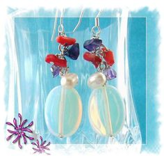 These lovely earrings are made using Mother of pearl beads, Coral and Amethyst chips and beautiful Crystal Opal beads and 925 silver hooks.  The