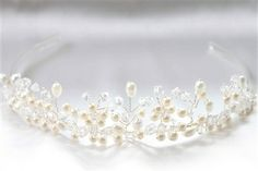 CAD$45.00 - A beautiful fresh water pearl bridal tiara. It makes an elegant bridal halo, wreath or crown, with a silver wire band for styling convenience. Karmabridal.com