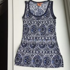 ~~ TORY BURCH  Blue Tank Top Eye catching 100% rayon top providing a comfy cool feel with a lovely blue and white motif that accentuates Tory's genius in fashion.  The top was cut a little low so I had a professional take it up a little at the shoulder. Awesome with white pants, cute sandals and a glass of wine, margarita or fabulous drink you enjoy most. Tory Burch Tops Tank Tops