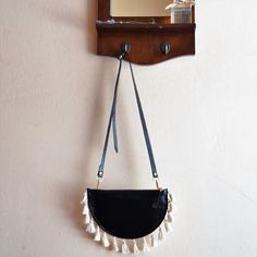 Black 'Lulu' clutch with beige tassels you can wear it in the different ways! Read item details for more...