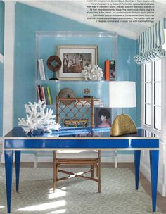 This nautical stripe Roman shade brings casual to this chic beach-side office space.