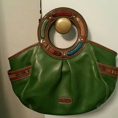 Beautiful Relic purse Beautiful green and jeweled color relic bag. Minimal use in great condition. Does not have a long strap. Relic Bags Totes