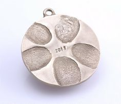 What a cute idea! Salt dough Charm with family fingerprints.