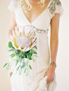 When did the tradition of walking down the aisle carrying a bouquet start? Since the pre-Christian era, walking down the aisle with a bouquet of. Single Flower Bouquet, Flower Bouquet Wedding, Bridesmaid Bouquet, Bridal Bouquets, Bridesmaid Dresses, Protea Bouquet, Protea Flower, Boquet, Wedding Bouquets