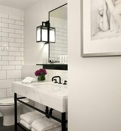 Black and white bath - so lovely.  The mirror and sconce combo is great.  21c Museum Hotel in Downtown Cincinnati, Remodelista