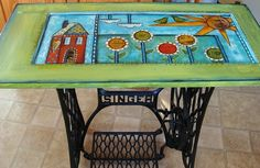 painted table--an old cupboard door on a vintage sewing machine stand