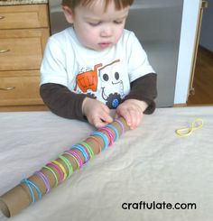 Craftulate: Cardboard Tube and Elastic Hair Bands [Fine Motor Fridays].  Use a strong cardboard tube (like from kitchen foil rather than paper towels) and colored hair elastic bands. This simple activity helps with pincer grasp, manual dexterity (adjusting grasp), bilateral coordination (using 2 hands together) and strengthening  fingers, hands, wrists and arms. Wow!