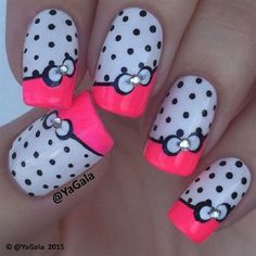 Pink, blue and white color combinations for a bow nail art. Blue polka dots are also used to accentuate the French tip while bows with rhinestones in the middle are added on top.