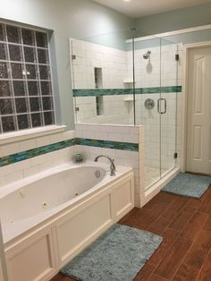 "Tub skirt inspired by Pinterest. ""Wood"" tile floors. Walls Sherwinn Williams rain washed"