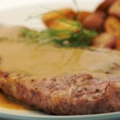 Rich, pork shoulder steak topped with a silky smooth dijon apple sauce. Not your mother's pork chops and apple sauce!