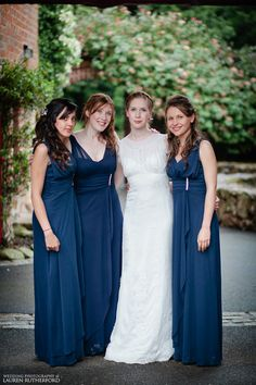 (Elizabeth's 3 person bridal party 2 bridesmaids on one side matron of honor on the other)