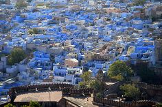 Jodhpur is the second largest city in Rajasthan in India and is also known as the blue city because the color gives an indigo aura to it with blue colored houses surrounding the Mehrangarh Fort. Jodhpur, Places Around The World, The Places Youll Go, Places To Visit, Around The Worlds, Virgin Gorda, New Delhi, Rajasthan Inde, Jaisalmer
