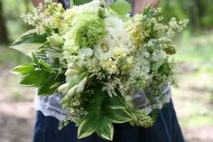 White Roses, White Stock, Yellow Stock, Tuberose, Green Hydrangea, Several Varieties Of Greenery & Foliage Including Hosta