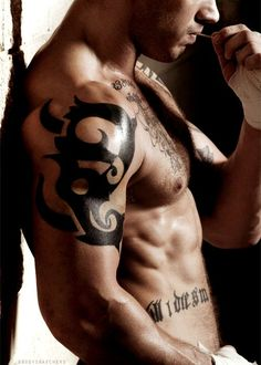tom hardy.. Tattooed and British, very nice...perfect in fact...just damn perfect!