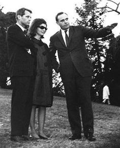 Jacqueline and Robert Kennedy visit Arlington with architect John Carl Warnecke who would ultimately design the plan for the permanent gravesite.