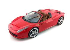 Mattel 1:18 Ferrari 458 Diecast Model Car X5527 This Ferrari 458 Italia Spider Diecast Model Car is Red and features working steering, wheels and also opening bonnet, boot with engine, doors. It is made by Mattel and is 1:18 scale (approx. 24cm / 9.4in long). The 458 Italia is the latest incarnation of the mid-rear engined berlinetta produced in Maranello. As every Ferrari, it is the result of an uncompromising design approach that integrates styling and aerodynamic technology. The…