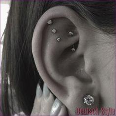 Loving this triple helix. Next piercing? Loving this triple helix. Next piercing? Helix and triple lobe pieunique triple helix piercThe Double Helix + Triple Tragus Piercings, Piercing Tattoo, Piercing Helix Avant, Auricle Piercing, Unique Ear Piercings, Female Piercings, Types Of Ear Piercings, Cartilage Earrings, Diy Earrings