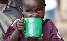 A Burundian refugee child drinks from a cup on the shores of Lake Tanganyika in Kagunga village in Kigoma region in western Tanzania, as they wait for MV Liemba to transport them to Kigoma township, May 18, 2015. REUTERS/Thomas Mukoya