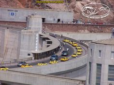 So cool! This is the Yellow Mustang Registry club in a organized drive over Hoover Dam. Must have been quite the sight!