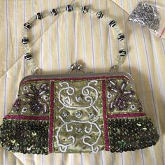 Gorgeous sequin evening purse. New w/o tags Pearls, sequin and muti color faux pearls. Gorgeous green satin lining with interior pocket. Also has a chain for cross body wear. Never worn Bags